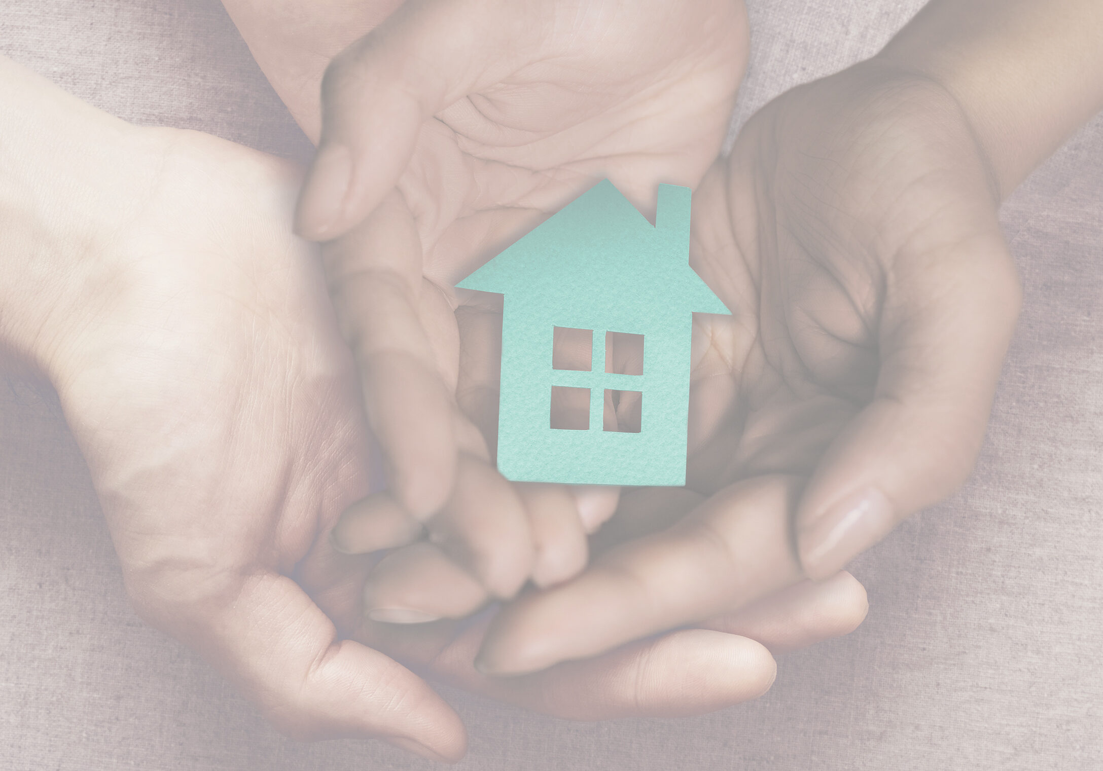 Adult and child hands holding paper house, family home and homeless shelter concept